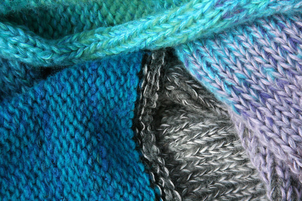 Winter Glow color way closeup of knitting detail of snood cowl knit by Wrapture by Inese