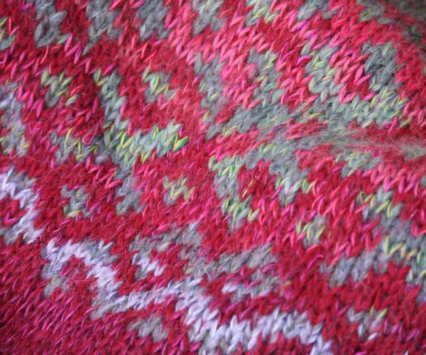 Roses inspired Latvian symbols sweater detail of pattern knitting
