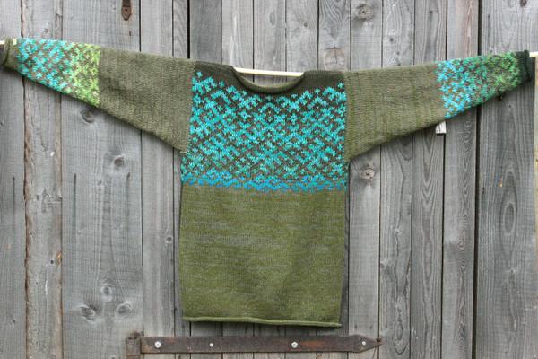 Forest Stream Latvian symbols sweater flat on side of woodshed size L