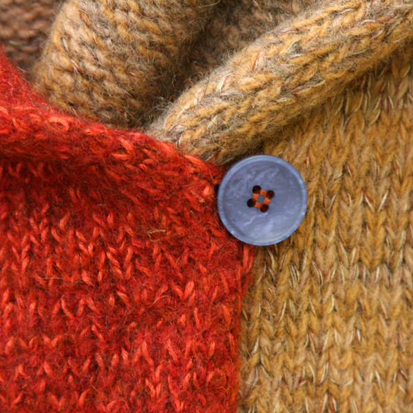 closeup detail of button on Sumac inspired felted boiled wool coat