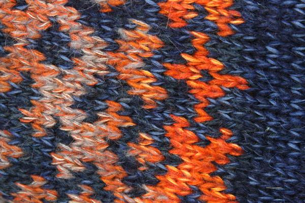 knitting fair isle Latvian symbols pattern closeup in Denim Sunset XL reversible sweater