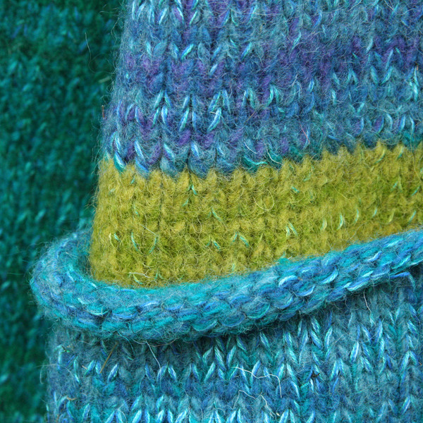 closeup detail of pocket detail on South Island inspired felted boiled wool coat