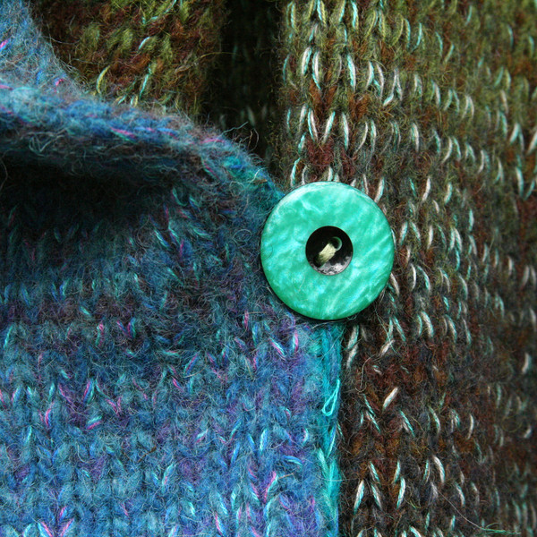 closeup detail of button on South Island inspired felted boiled wool coat