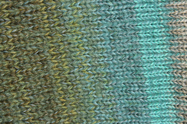 detail in closeup of unique ombre knitting with in scalloped hem sweater dress knit by Wrapture by Inese inspired by the edge of a Fjord in Norway color story