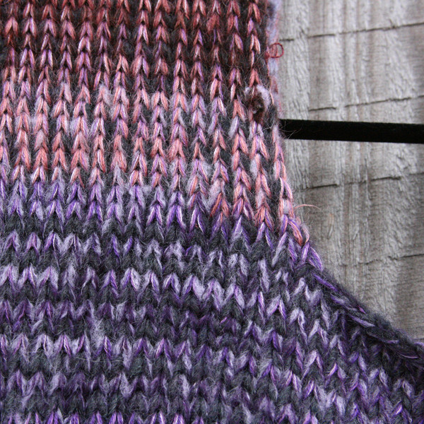 closeup detail of neckline detail and unique ombre knitting of A-line sarafan dress knit by Wrapture by Inese