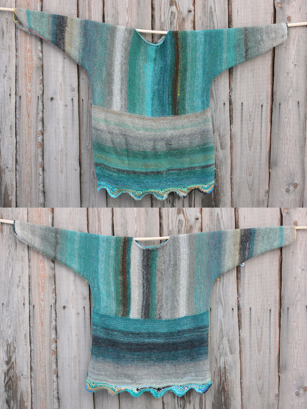 Fjord edge inspired scalloped hem reversible sweater dress purl side shown of both sides on wood wall Wrapture by Inese