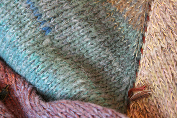 Fragments turquoise blue gold brown lavender closeup of knitting detail showing how Inese does her unique color blends