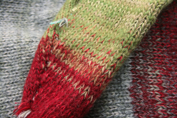 Yak and Pony grey red green blue closeup of knitting detail showing how Inese does her unique color blends