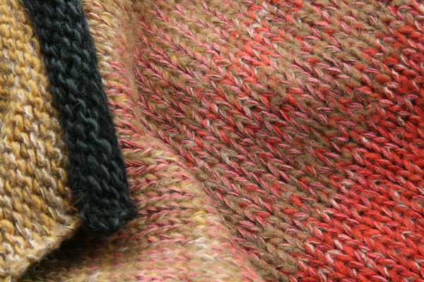 Wild Rose Hips Liene sweater coat wool, mohair, cotton and silk blend. knitting detail closeup of Ineses unique way of blending colors in her knits.