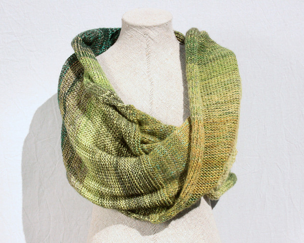Forest Land shawl wrap on dress form knit by Inese for Wrapture by Inese in green olive lime grass