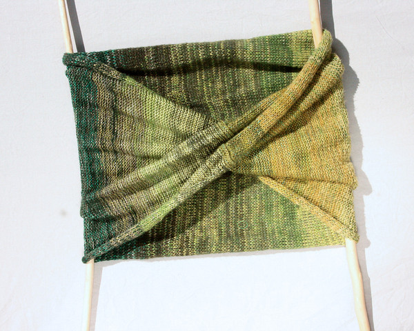 Forest Land shawl wrap flat on white background showing mobius infinity twist, knit by Inese for Wrapture by Inese in green olive lime grass