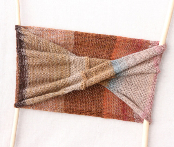 Pink birch inspired knit loop scarf flat on white background