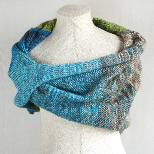New Zealand shawl wrap on dress form knit by Inese for Wrapture by Inese in blue teal green beige