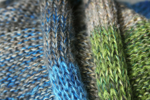 New Zealand shawl wrap detail of knitting in blue teal green beige