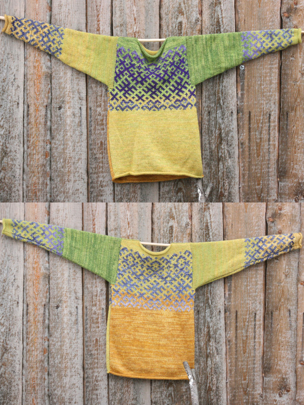 view of both sides of reversible unisex Chartreuse Green Latvian symbols sweater size M hung on woodshed wall, knit by Inese Iris Liepina