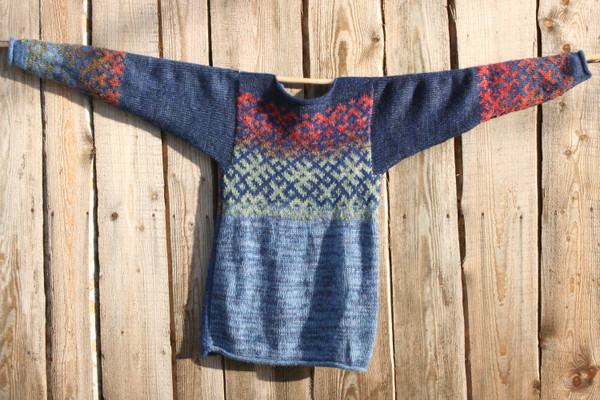 Sapphire Latvian symbols sweater flat on wooden wall background size M Wrapture by Inese
