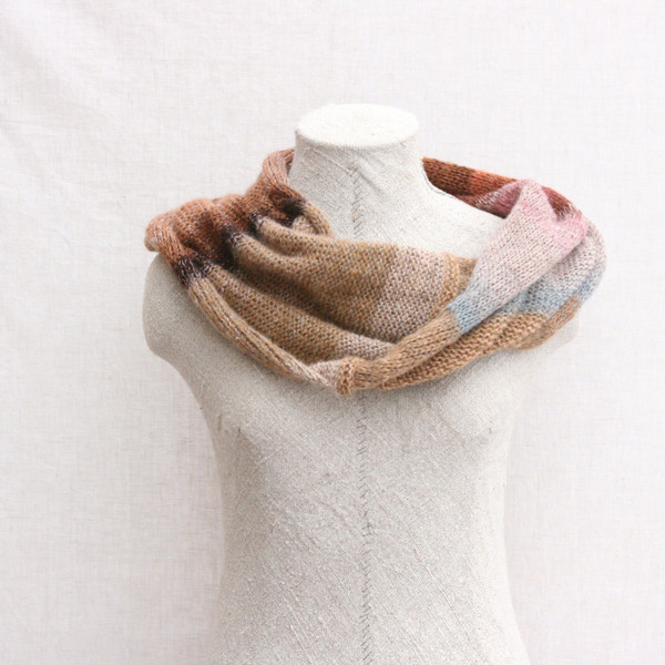 Winter Birch kid mohair and silk one of a kind loop scarf on dress form with white background. Knit by Inese in taupe beige, mauve, rust