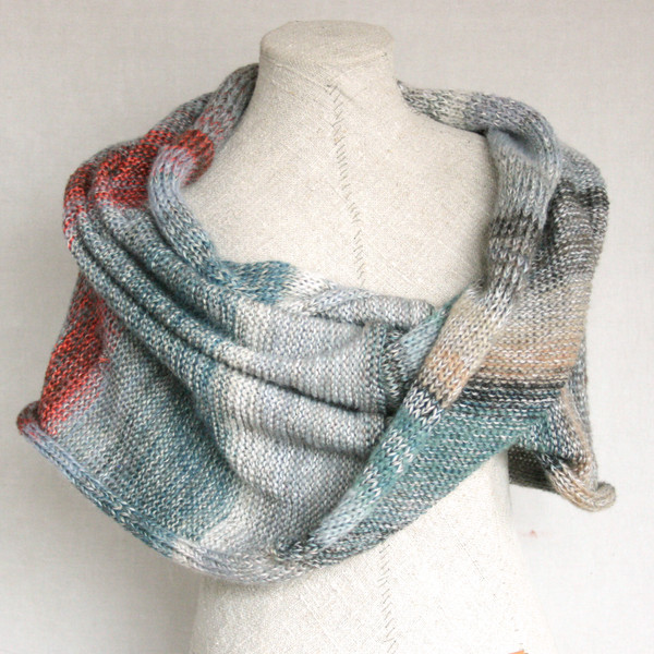 Fjord rocks color card knit into a shawl wrap by Wrapture by Inese on a dress form