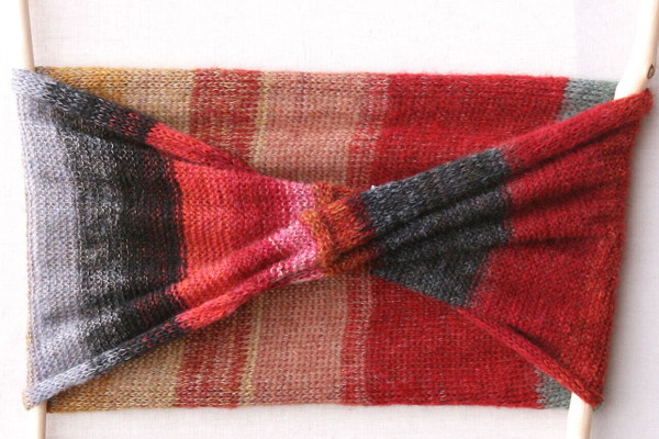 Rakvag color card inspired loop scarf knit by Inese for Wrapture by Inese flat on wall on with white background