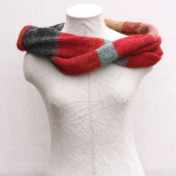 Rakvag color card inspired loop scarf knit by Inese for Wrapture by Inese on dress form with white background