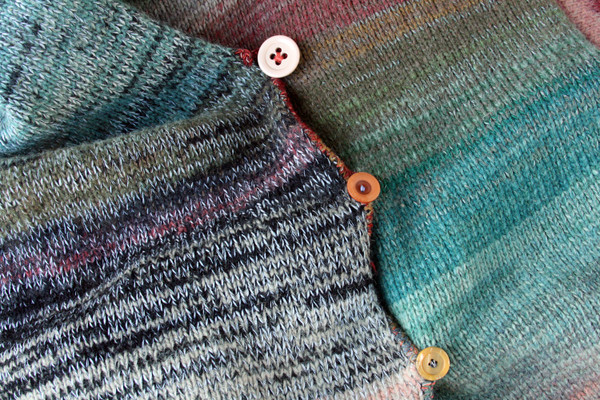 Button detail with missmatched buttons and crochet button loops on ombre colored birch tree inspired felted wool coat knit by Wrapture by Inese