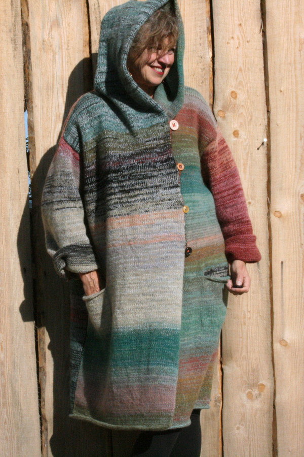 hood ear warmers option on one of a kind felted wool coat knit by Wrapture by Inese shown as worn by Inese Iris Liepina