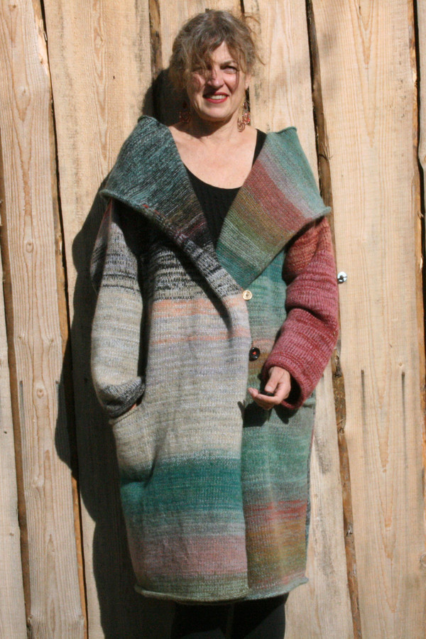 Front view of low shawl collar option on one of a kind felted wool coat knit by Wrapture by Inese shown as worn by Inese Iris Liepina