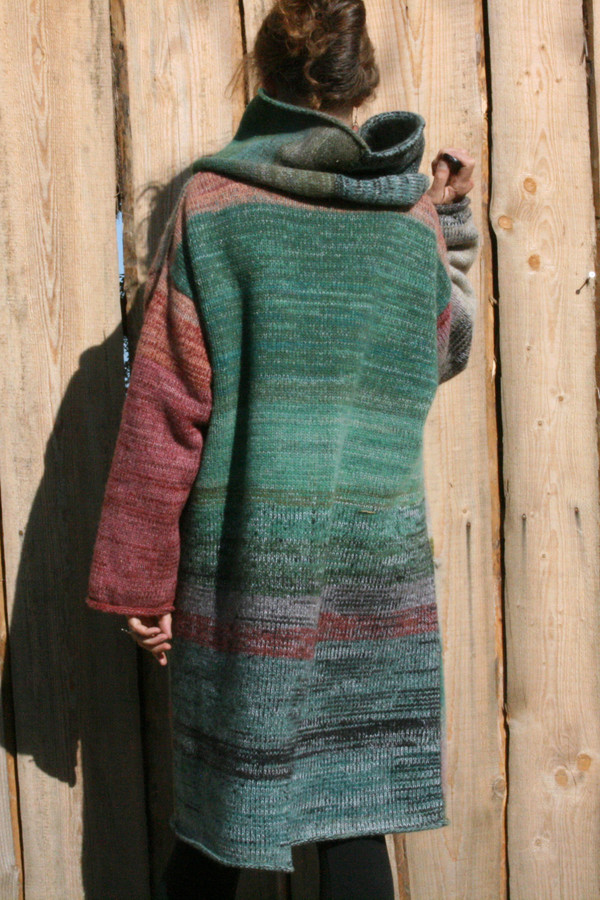 Back view or cowl collar option on one of a kind felted wool coat knit by Wrapture by Inese shown as worn by Inese Iris Liepina