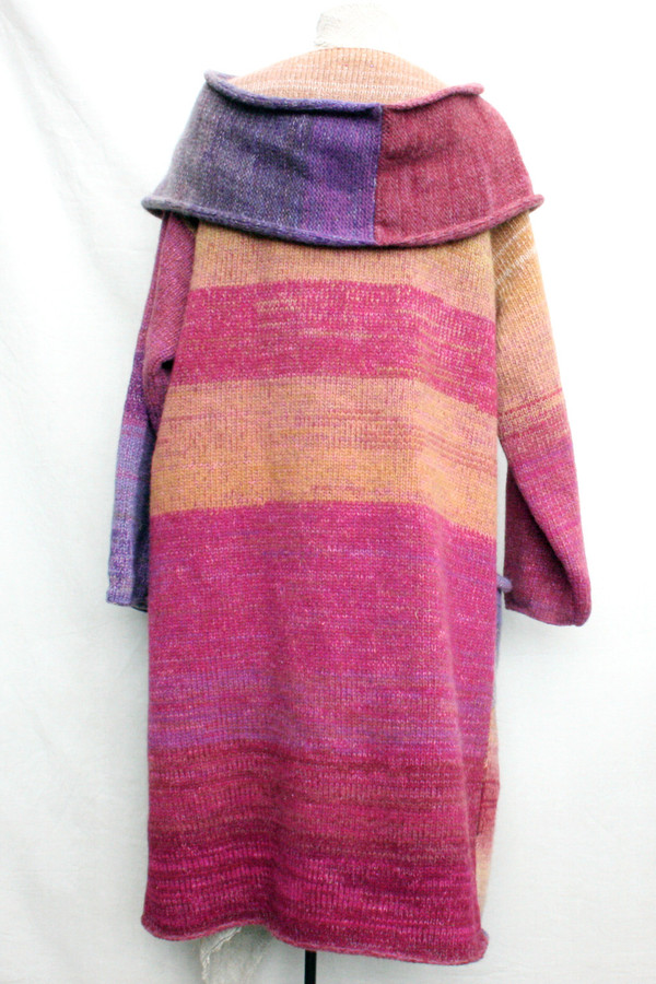 One of a kind felted wool coat knit by Inese with colors inspired by Purple Avens or Bitene flowers. Size M , back view shown on dress form with shawl collar and pocket details.