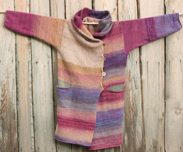 One of a kind felted wool coat knit by Inese with colors inspired by Purple Avens or Bitene flowers. Size M , Photographed on my woodshed with shawl collar buttoned into a snug collar cowl.