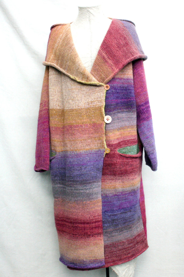 One of a kind felted wool coat knit by Inese with colors inspired by Purple Avens or Bitene flowers. Size M , shown on dress form with shawl collar and pocket details.