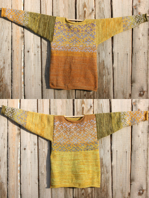 view of both sides of reversible mustard yellow Latvian symbols sweater size L Wrapture by Inese as hung flat on wood wall