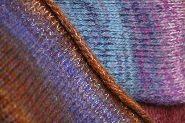 One of a kind Plum S felted wool coat rolled hem detail closeup. Knit by Wrapture by Inese
