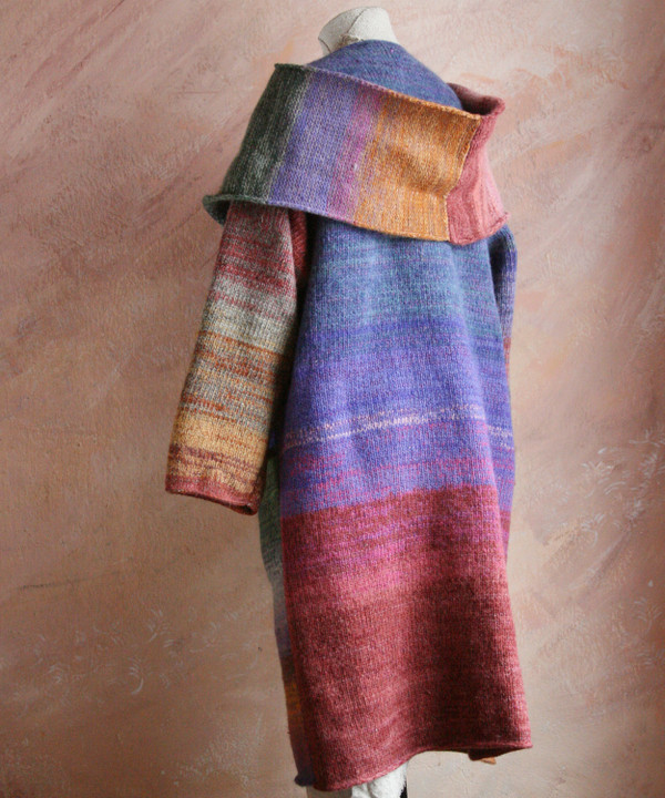 One of a kind felted wool coat knit by Inese with colors inspired by a plum tree. Size S , back view shown on dress form with shawl collar and pocket details.