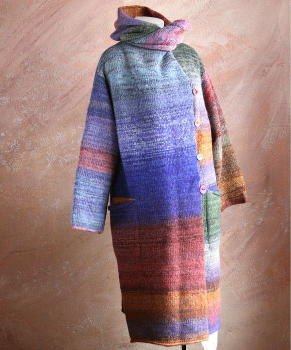 One of a kind felted wool coat knit by Inese with colors inspired by Plum. Size S , shown on dress form with shawl collar buttoned into a snug collar cowl.