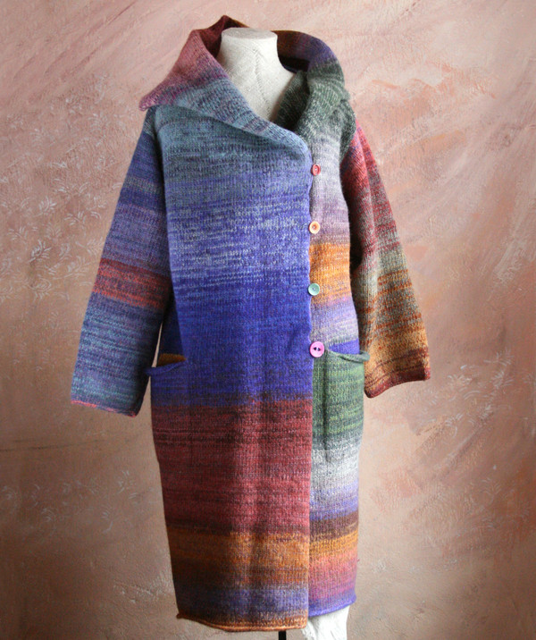 One of a kind felted wool coat knit by Inese with colors inspired by my Plum tree. Size S , shown on dress form with shawl collar buttoned into a snug collar cowl.