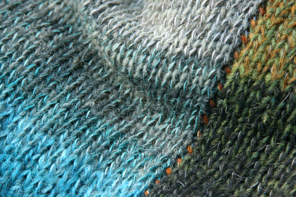 closeup of knitting detail with contrast stitched seam in Greenstone calf length tank dress knit by Inese Iris Liepina