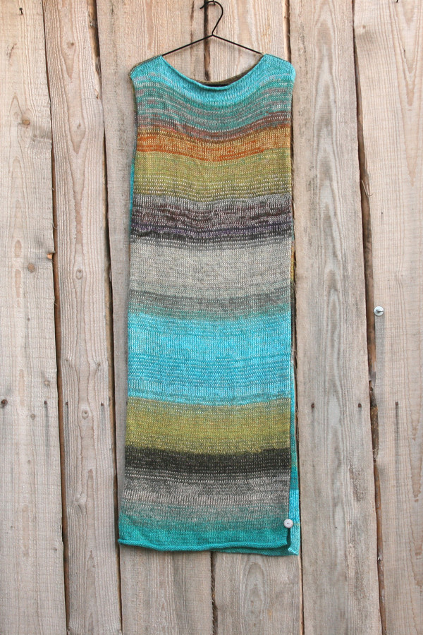 Greenstone River color card inspired reversible tank dress knit by Inese for Wrapture by Inese  on coat hanger on wooden background