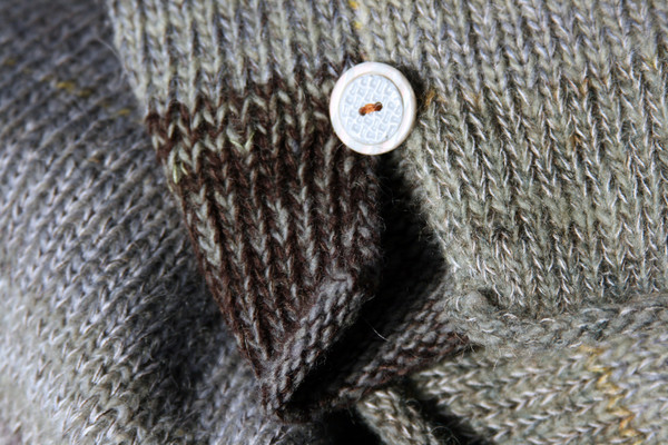 detail of side slit and button with ombre color change in knit Grey Leaves dress, knit by Inese Iris Liepina of Wrapture by Inese