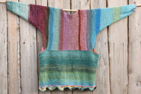 Barcelona Door color way of Oversized chunky knit sweater dress OS one of a kind wool kid mohair cotton silk hand crochet edge, knit by Wrapture by Inese flat on a wooden wall with knit side out
