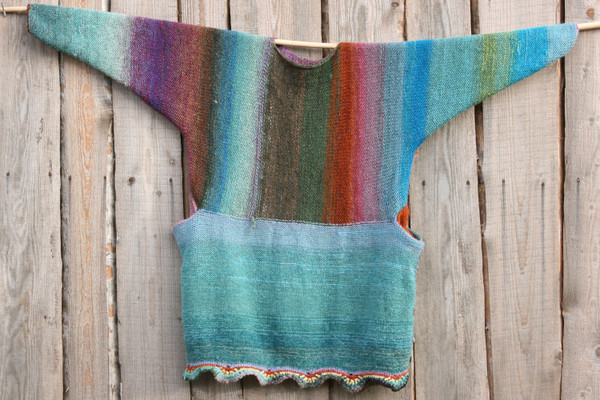 Barcelona Door color way of Oversized chunky knit sweater dress OS one of a kind wool kid mohair cotton silk hand crochet edge, knit by Wrapture by Inese flat on a wooden wall with purl side out