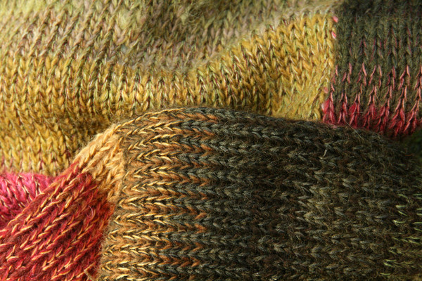 closeup of knitting detail in Waterlily Fronds calf length tank dress knit by Inese Iris Liepina