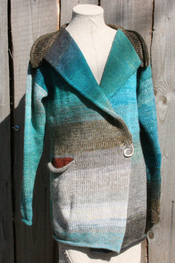 Greenstone Blue color card inspired Liene Sweater Coat in size  M on dress form with wood wall background - Wrapture by Inese