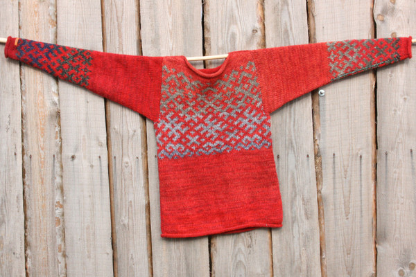 Fire red Latvian symbols sweater size S for him or her to wear knit by Inese using local Latvian wool, kid mohair, silk, cotton, hung flat on wood wall, reversible showing one side