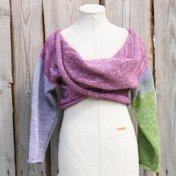 Lilac Buds lavender green x-tee on dress form showing crossover worn in front in front of wood wall knit and designed by Inese for Wrapture