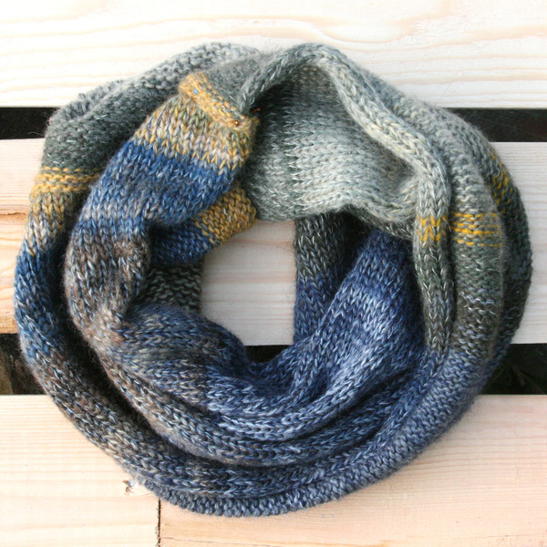 Winter Sun color way snood cowl flat on wood pallet background, knit by Inese Iris Liepina for Wrapture by Inese.