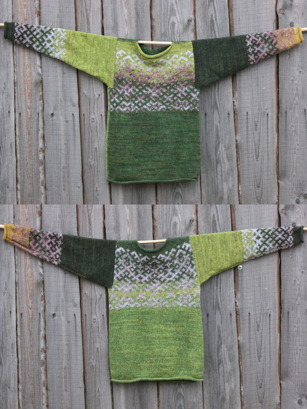 view of both sides of reversible unisex Oak Green Latvian symbols sweater size M hung on woodshed wall, knit by Inese Iris Liepina