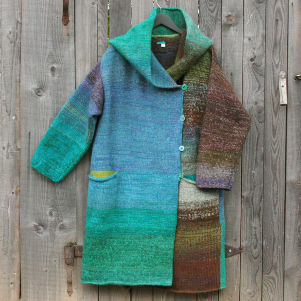 One of a kind felted wool coat knit by Inese with colors inspired by the South Island of New Zealand. Size M. Photographed on my woodshed with shawl collar buttoned into a snug collar cowl