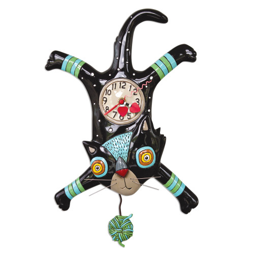 """This whimsical clock features:  •    measures 16.25″ x 10.25″ •    hand-painted heart hands •    swinging yarn ball pendulum •    cast in resin, finished by hand •    requires """"AA"""" battery"""