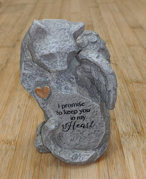 Ceramic resin with gold painted heart detail and embossed stamped message.